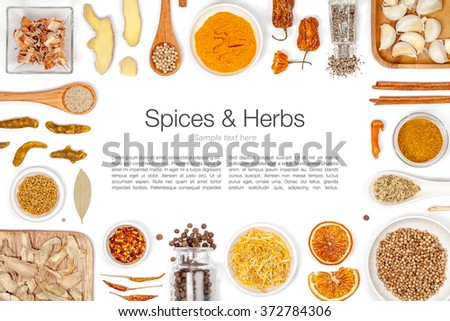 various spices and herbs on white background with copy space. flat lay frame composition top view - stock photo
