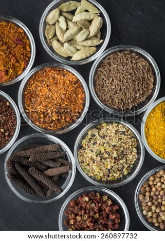 Various spices in small bowls from above - stock photo