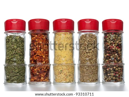 Various spices in small glass bottles, close up - stock photo