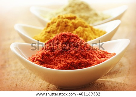Various spices on wooden background - stock photo