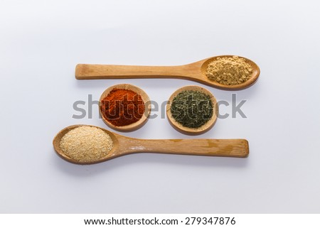 various spices to cook a variety of flavors, ginger, chili, garlic, thyme, dill, fenugreek, red peppers, nutmeg  - stock photo