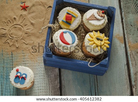 Various Summer Cupcakes In A Wooden Box - stock photo