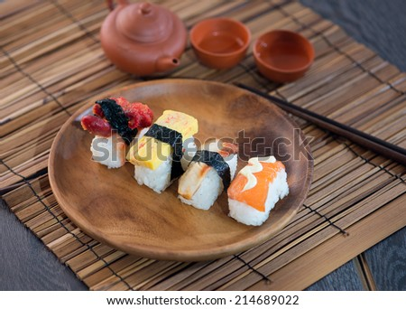 various sushi on plate - stock photo