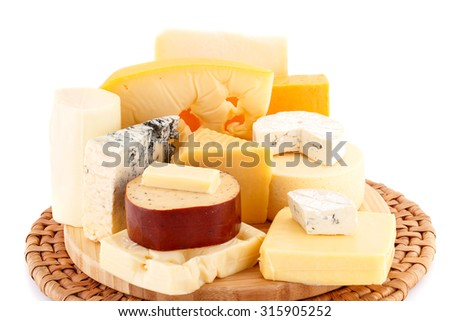 Various type of cheese on wooden board closeup picture. - stock photo