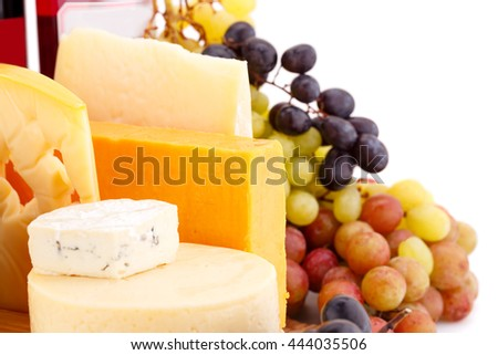 Various type of cheese,wines and grapes closeup picture.