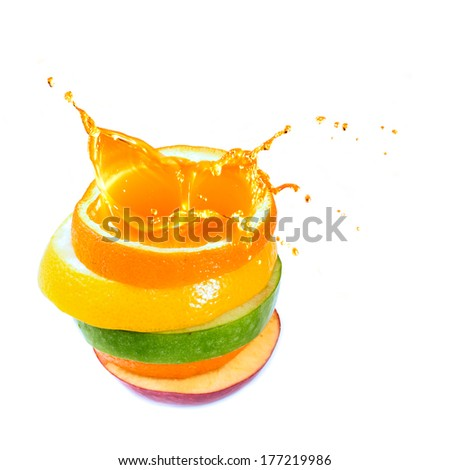 various type of fruit slices stacked with splash - stock photo
