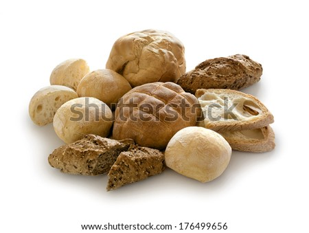 various types of bread on a white table