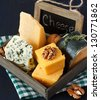 Various types of cheese composition and walnuts with vintage chalk blackboard tag. - stock photo