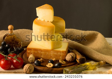 Various types of cheese in an rustic surrounding - stock photo