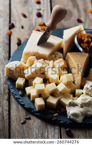 Various types of cheese on the table, selective focus - stock photo