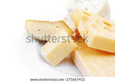various types of cheese on white platter isolated on white background - stock photo