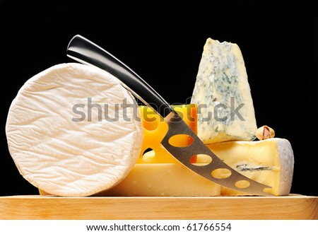 Various types of cheese over black - stock photo