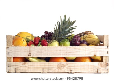 Various types of fruit stored in wooden box on white background - stock photo