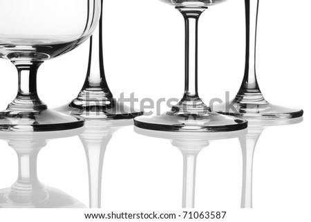 Various types of glasses on white background, champagne flute, champagne saucer, martini glass, brandy glass.