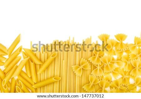 Various types of pasta on a white background - stock photo