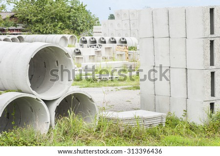 Various types of precast concrete for wells and drains in storage