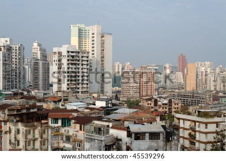 Various types of residential buildings in Macau (China's Special Administrative Region) with different types of roof extensions built by the residents. - stock photo
