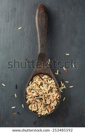 Various types of rice in bowl, close-up - stock photo