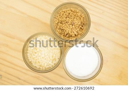various types of sugar in glass bottles - stock photo