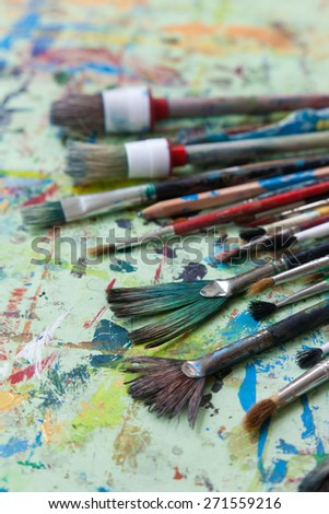 various used brush on the painting table - stock photo
