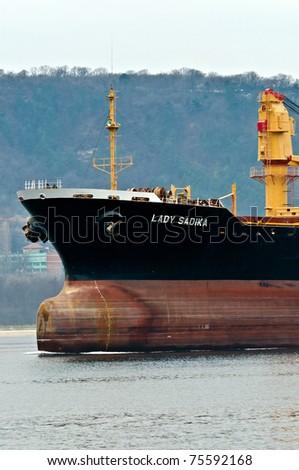 VARNA, BULGARIA - APR 08: Cargo ship LADY SADIKA (Year Built: 1984, Flag: Malta) sails away into open sea after a short stay in Varna-west port on April 08, 2011 in Varna, Bulgaria. - stock photo