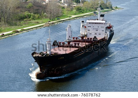 VARNA, BULGARIA - APR 22: Cargo ship LINDEN (Year Built: 1977, Flag: Moldova) sails away into open sea after a short stay in Varna-west port on April 22, 2011 in Varna, Bulgaria.