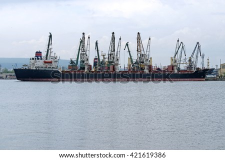 VARNA, BULGARIA - APRIL 24, 2016: Bulk Carrier SKIPPERS Y (Built: 1984, Flag:  Sierra Leone) is loaded with wheat in Port of Varna-East.