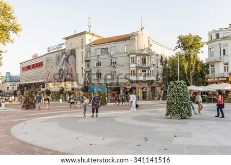 VARNA, BULGARIA - AUG 08, 2015: Tourists walk on a pedestrian street in downtown. Architecture and streets of the town of Varna in Bulgaria. Picture taken in the evening during a trip to Bulgaria