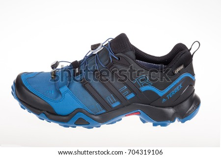 Varna , Bulgaria - AUGUST 12, 2017 : ADIDAS TERREX SWIFT sport shoe. Product shot. Adidas is a German corporation that designs and manufactures sports shoes, clothing and accessories