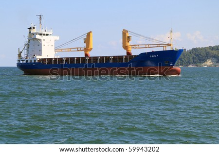 VARNA, BULGARIA - AUGUST 23: Cargo ship DARJA (Year Built: 1984, Flag: Belize, DeadWeight: 4145 t) sails into Port of Varna-West to be loaded with goods on August 23, 2010 in Varna, Bulgaria. - stock photo
