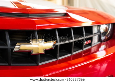 Varna, Bulgaria - Circa December 2015: New red Chevrolet Camaro SS. Front close-up. Showroom 'Perfect Auto'.  - stock photo