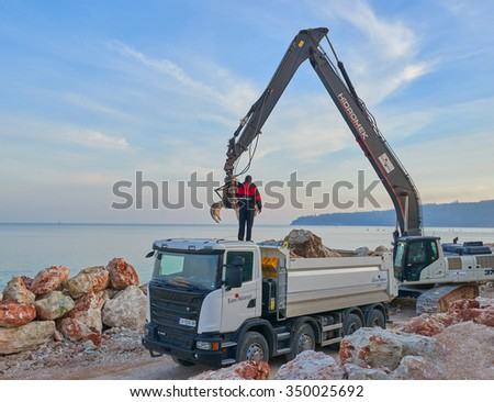 VARNA, BULGARIA, 07.12.2015: Construction work on the strengthening of the pier by the European Alliance near the port of Varna in Bulgaria - stock photo