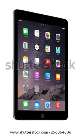 Varna, Bulgaria - February 02, 2014: Half turned Apple Space Gray iPad Air 2 with touch ID displaying iOS 8 homescreen, designed by Apple Inc. Isolated on white background. The whole image in focus. - stock photo
