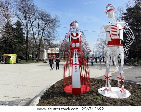 Varna, BULGARIA - February 28, 2014: Instalation made from iron of Bulgarian folklore  heroes Pizho and Penda symbol and wish for good health. The holiday is celebrated on the first day of March.