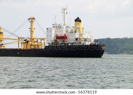 VARNA, BULGARIA - JULY 01: Cargo ship MANA (Year Built: 1978, Flag: Panama, DeadWeight: 17089 t) is sailing away into open sea after a short stay in Port of Varna on July 01, 2010 in Varna, Bulgaria.