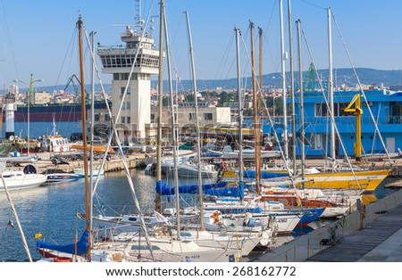 Varna, Bulgaria - July 20, 2014: Sailing yachts and pleasure boats stand in port of Varna