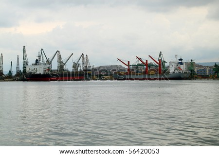 VARNA, BULGARIA - JUNE 25: Cargo ship CICLOPE (left) and cargo ship MSC EQUATOR are moored in Port of Varna and being loaded with goods on June 25, 2010 in Varna, Bulgaria