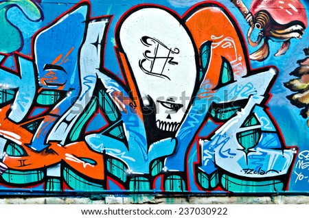 """VARNA, BULGARIA - JUNE 5, 2011: Fraction from the vast Eighty meters long graffiti painted on a concrete wall at Port of Varna as part of the """"Creatures from Black Sea"""" Sprite Graffiti Jam 2011. - stock photo"""