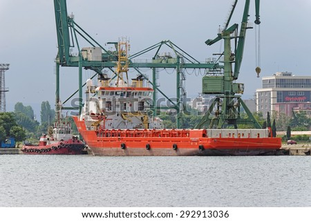 Varna, BULGARIA - June 21, 2015: Supply ship NORMAND CARRIER moored at Port of Varna-East. The vessel will take part in the construction of gas pipeline from Russia to Europe. - stock photo