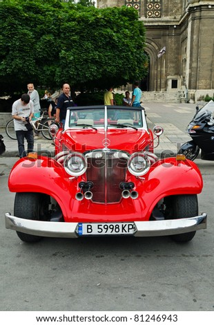 "VARNA, BULGARIA - JUNE 25: The annual Retro rally ""Old capitals"" finished for the first time in town of Varna on June 25, 2011 in Varna, Bulgaria. Replica of Mercedes-Benz 500 , 1936 - stock photo"