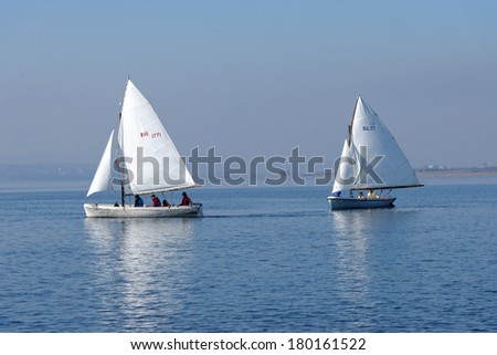 """VARNA, BULGARIA - MARCH 03, 2014: The national sailing boat race """"March the third"""", a national competition conducted in the Varna lake with yawl-6 boats. - stock photo"""
