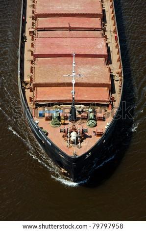 VARNA, BULGARIA - MAY 15: Cargo ship ALEXANDR KARASTOYANOV (Flag: Ukraine,  IMO: 8947618) sails into open sea loaded with 1700 t of metal scrap in bulk on May 15, 2011 in Varna, Bulgaria. - stock photo