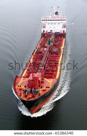 VARNA, BULGARIA - NOVEMBER 17: Cargo ship EYLEN (Built: 1981, Flag: Malta) sails into Port of Varna-West to be loaded with 6000 tons of vitriol on November 17, 2010 in Varna, Bulgaria. - stock photo