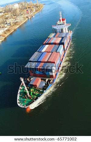 VARNA, BULGARIA - NOVEMBER 18: Moroccan cargo ship OUED ZIZ (Year Built: 1998, DeadWeight: 7600 t) sails into Port of Varna-West on November 18, 2010 in Varna, Bulgaria. - stock photo