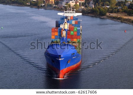VARNA, BULGARIA - SEPTEMBER 26: Turkish cargo ship HILDE A (Year Built: 2005, DeadWeight: 22033 t) sails into Port of Varna-West to be loaded with containers on September 26, 2010 in Varna, Bulgaria. - stock photo