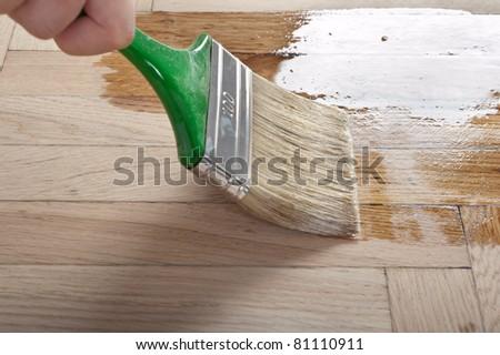 Varnish brush strokes on a wooden floor - stock photo