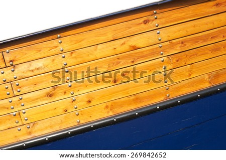 Varnished wood hull of boat with nails, wood texture for background - stock photo