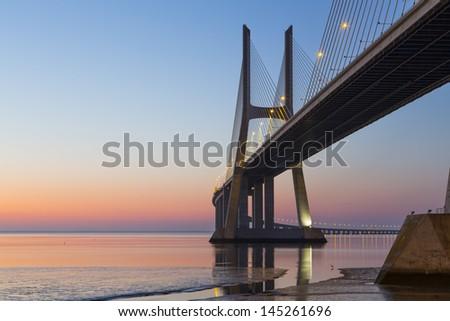 Vasco da Gama Bridge at sunrise - stock photo