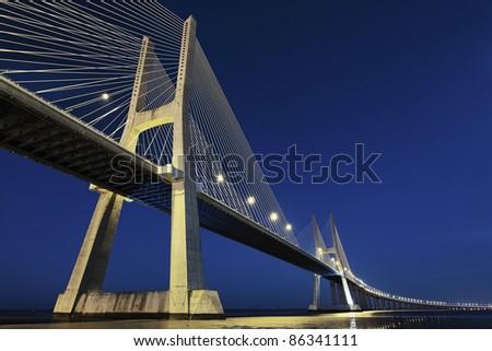 Vasco da Gama bridge in Lisbon by night, Portugal - stock photo