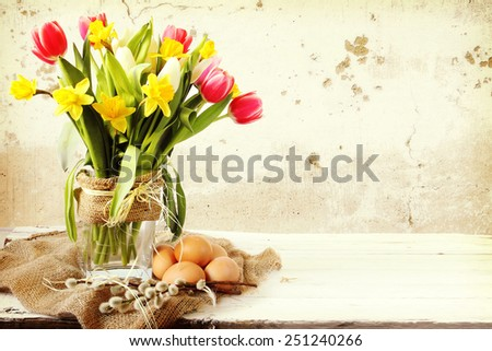 Vase of Tulips and easter eggs - stock photo